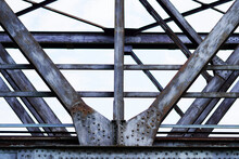 Close Up Of The Metal Structure Of An Old Railway Bridge In Germany. Steel Components.