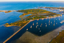 Aerial View Of Yacht Club And Marina Along Side An Island And Lagoon