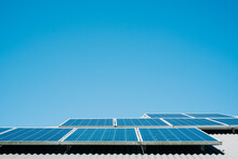 Horizontal Shot Of Solar Panels With Blue Sky In The Background