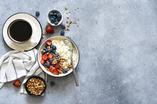 Breakfast - Cottage Cheese With Berries And A Cup Of Coffee, Top View. Granola With Nuts, Honey And Strawberries.
