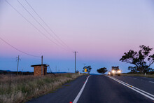 Cars Driving On Country Road At Dusk With Headlights On - Low Visibility Driving