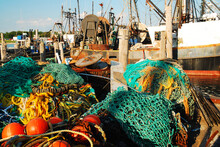 Netting And Other Fishing Gear Sits On A Commercial Fishing Fleet Dock