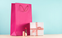 Cosmetics With A Present Box And Pink Paper Bag.