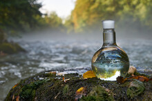 Flask With Clear River Water.