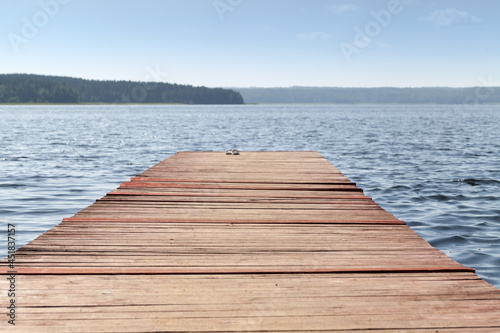 Empty wooden swimming pier on a sunny day