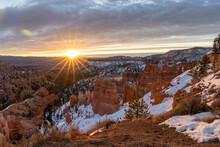 Sunburst Sunrise Over The Unique Landscape Of Bryce Canyon.