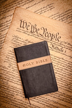 Holy Bible And Small Cross On The Constitution