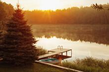 Summer Beautiful Landscape With  Boat On Lake  At Sunrise
