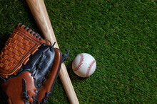 Baseball And Wood Bat With Mitt On Grass Field Overhead View