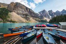 Canoes On Moraine Lake During Summer In Banff National Park, Alberta, Canada.