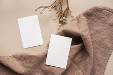 Flatlay Of Aesthetic Parisian Styled Business Branding Template. Blank Paper Sheet Card With Mockup Copy Space, Dry Flowers Branch And Cloth On Neutral Beige Background. Flat Lay, Top View