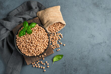Peeled, Raw Chickpeas In A Bowl On A Dark Background.
