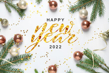 Happy New Year! Flat Lay Composition With Baubles And Green Branches On White Background