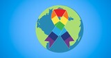 Rainbow ribbon over globe on blue background