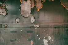 Very Old Warehouse Door Panels With Green And Orange Peeling Paint