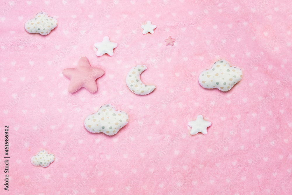 Baby dream concept clouds, stars on pink blanket