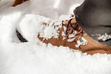 Trekking Boot On Leg Of Crop Man In Winter