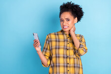 Photo Of Young African Girl Unhappy Negative Moody Hand Touch Neck Unwell Use Cellphone Isolated Over Blue Color Background