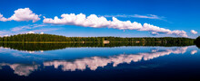 Beautiful Panorama With A Long Cloud Reflected In The Lake