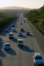 Traffic Heading In Both Directions On Motorway In Afternoon Light