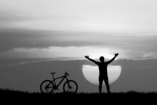 Silhouette Of A Person On A Bicycle