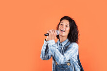 Girl Singing. Vocal School Concept. Karaoke Club. Music Is My Life. Woman Sing With Mic. Cheerful Event Manager. Host Of Events. Have Fun On Party. Happy Singer With Microphone. Copy Space