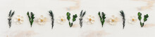 Top View Image Of White And Green Flowers Composition Over Wooden Background .Flat Lay
