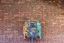 Jamestowne, VA, USA - April 1, 2013: Historic Site. English Royal Coat Of Arms Against Red Brick Wall. Motto Is Dieu Et Mon Droit.
