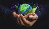 Fototapeta Kawa jest smaczna - ESG Concept. Nature Meet Technology. Green Energy, Renewable and Sustainable Resources. Environmental and Ecology Care. Hand Embracing Green Leaf and Globe