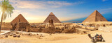 Fototapeta Kawa jest smaczna - Egypt Pyramids and Sphinx panorama behind the palm with a camel lying by, Cairo, Giza