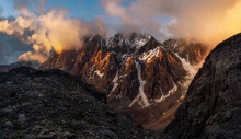 Majestic Glacier Is Illuminated By The Bright Golden Evening Sun. Panoramic View. Altai Mountains.