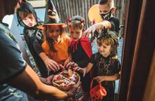Children Celebrate Halloween Dressed Up In Costumes. Selective Focus.