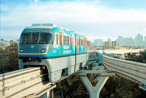 Dubai, United Arab Emirates – February 7, 2021: Monorail locomotive in Dubai on a background of skyscrapers.