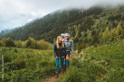Travel family lifestyle group people hiking in foggy forest mountains adventure vacations tour outdoor eco tourism concept
