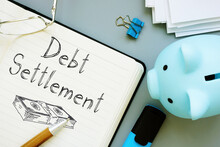 Debt Settlement Is Shown On The Business Photo Using The Text