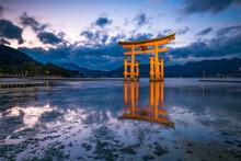 Red Torii Gate Of The Itsukushima Shrine On Miyajima Island, Japan