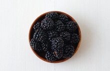 Ripe Blackberries, Wooden Bowl With Fresh Blackberries From Local Farmers Market On White Wooden Table. Flat Lay, Top Down View.