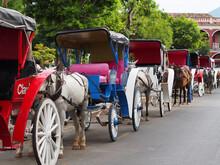 Granada, Nicaragua - 25.03.2015: Horse-drawn Carriages In The Main Square Of Granada