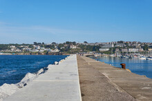 A View From The Stone Front Pathway Pier Of Brixham Breakwater And Marina In Brixham In Devon On The English Coast.