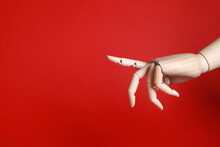 Wooden Mannequin Hand On Red Background. Space For Text
