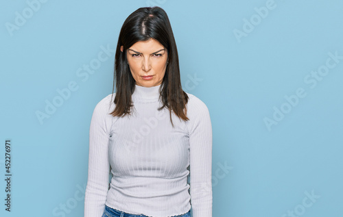 Fotografia Beautiful brunette woman wearing casual clothes skeptic and nervous, frowning upset because of problem