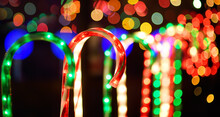 Close-up Photo Of Christmas And New Year Decorations. Fence Decorated With A Garland Like Multicolored Candy Stick Cane.