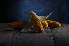Corn Cobs On A Vintage Wooden Table