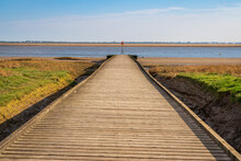 A Wooden Path Leading To The Shore Of The River Ribble, Seen In Lytham, Lancashire, England, UK