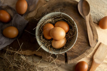 Eggs In Plate On Wooden Table