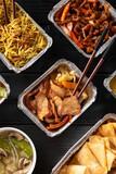 Fototapeta Kawa jest smaczna - Chinese takeaway food. Kung Po king prawns, crispy won ton, roast pork char siu, prawn curry, shredded beef, soup