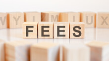Fees Word Made With Building Blocks, Concept.