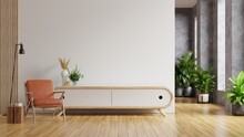 Leather Armchair And A Wooden Cabinet In Living Room Interior With Plant,White Wall.
