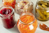 Fototapeta Kawa jest smaczna - Fermented food. Canned vegetables. Pickled carrot, beet, sour cabbage and other organic preserves in mason jars. Healthy vegan cooking