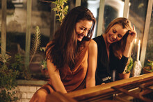 Best Friends Having Fun Playing The Piano In A Hotel
